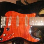 orange figured maple pickguard black strat