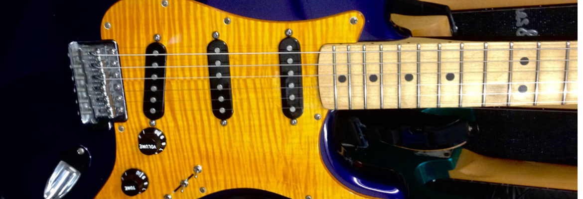 gold stain real figured maple pickguard blue strat