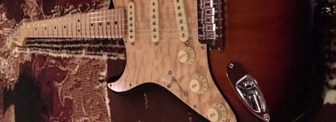 Quilted maple pickguard in natural stain